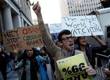 Occupy Wall Street protesters march towards Zuccotti Park in New York's Financial District, Wednesday, Oct. 5, 2011. (AP Photo/Jason DeCrow) By Jason DeCrow