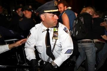 New York City police try to stop protesters who tried to enter Wall Street after an Occupy Wall Street march Wednesday, Oct. 5, 2011 in New York. (AP Photo/Craig Ruttle) By Craig Ruttle