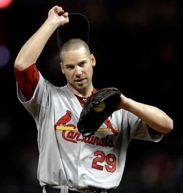 St. Louis Cardinals starting pitcher Chris Carpenter adjusts his cap during the sixth inning of a baseball game against the Houston Astros on Wednesday, Sept. 28, 2011, in Houston. (AP Photo/David J. Phillip) By David J. Phillip