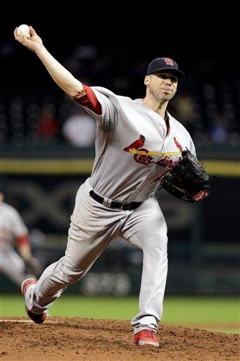 St. Louis Cardinals' Chris Carpenter delivers his final pitch of a baseball game against the Houston Astros Wednesday, Sept. 28, 2011, in Houston. Carpenter threw a two-hitter in the Cardinals' 8-0 win. (AP Photo/David J. Phillip) By David J Phillip
