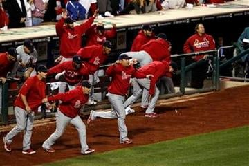 The St. Louis Cardinals bench reacts at the end of the ninth inning of baseball's Game 5 of the National League division series with the Philadelphia Phillies Friday, Oct. 7, 2011 in Philadelphia. Cardinals won 1-0. (AP Photo/Mel Evans) By Mel Evans