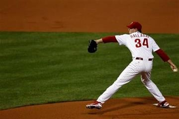 Philadelphia Phillies starting pitcher Roy Halladay throws the ball during the first inning of baseball's Game 5 of the National League division series with the St. Louis Cardinals Friday, Oct. 7, 2011 in Philadelphia. (AP Photo/Mel Evans) By Mel Evans