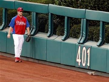 Philadelphia Phillies pitcher Roy Oswalt walks behind a squirrel on the field before baseball's Game 5 of the National League division series with the St. Louis Cardinals Friday, Oct. 7, 2011 in Philadelphia. (AP Photo/Matt Slocum) By Matt Slocum
