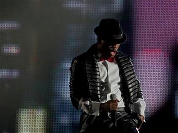 US singer Ne-Yo performs at the Michael Forever the Tribute Concert, at the Millennium Stadium in Cardiff, Saturday, Oct. 8, 2011. (AP Photo/Joel Ryan) EDITORIAL USE ONLY By Joel Ryan