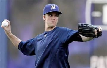 Milwaukee Brewers starting pitcher Zack Greinke throws during a practice session for baseball's National League championship series against the St. Louis Cardinals Saturday, Oct. 8, 2011, in Milwaukee. (AP Photo/David J. Phillip) By David J. Phillip