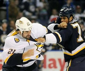 St. Louis Blues' Ryan Reaves, right, fights with Nashville Predators' Zack Stortini (21) in the first period of an NHL hockey game, Saturday, Oct. 8, 2011, in St. Louis. (AP Photo/Bill Boyce) By Bill Boyce