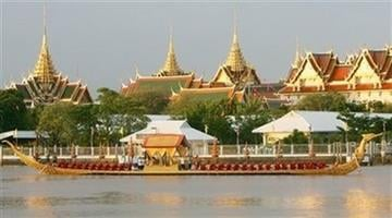 The Suphannahongse Royal State Barge cruises past the Grand Palace on the Chao Phraya river, Monday, June 12, 2006, in the celebration, marking Thai King Bhumibol Adulyadej's 60th year on the throne. (AP Photo/Sakchai Lalit) By AP Photo/Sakchai Lalit