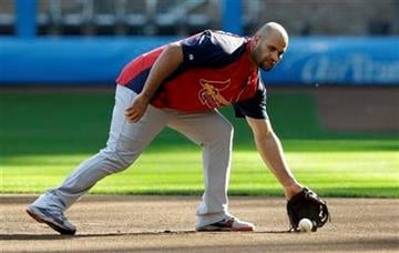 St. Louis Cardinals' Albert Pujols fields a ground ball during a practice session for baseball's National League championship series against the Milwaukee Brewers Saturday, Oct. 8, 2011, in Milwaukee. (AP Photo/David J. Phillip) By David J. Phillip
