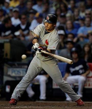 St. Louis Cardinals' Rafael Furcal hits a single during the seventh inning of Game 1 of baseball's National League championship series against the Milwaukee Brewers Sunday, Oct. 9, 2011, in Milwaukee. (AP Photo/Matt Slocum) By Matt Slocum