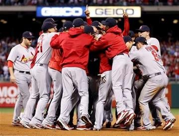 The St. Louis Cardinals react after their 1-0 win over the Philadelphia Phillies in baseball's Game 5 of the National League division series Friday, Oct. 7, 2011 in Philadelphia. (AP Photo/Matt Rourke) By Matt Rourke