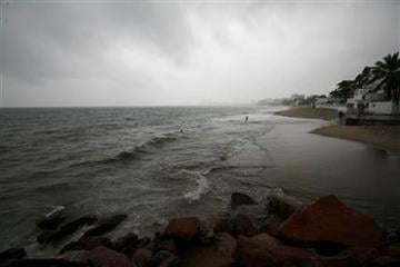 View of the main beach under heavy clouds in Puerto Vallarta, Mexico, Monday Oct. 10, 2011. Hurricane Jova strengthened to a major, Category 3 hurricane Monday as it marched toward Mexico's Pacific coast. (AP Photo/Marco Ugarte) By Marco Ugarte