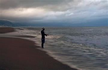 A man fishes on the the shore of Puerto Vallarta, Mexico, Monday Oct. 10, 2011. Hurricane Jova strengthened to a major, Category 3 hurricane Monday as it marched toward Mexico's Pacific coast. (AP Photo/Marco Ugarte) By Marco Ugarte