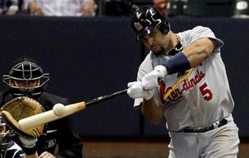 St. Louis Cardinals' Albert Pujols hits an RBI double during the fifth inning of Game 2 of baseball's National League championship series against the Milwaukee Brewers Monday, Oct. 10, 2011, in Milwaukee. (AP Photo/Jeff Roberson) By Jeff Roberson