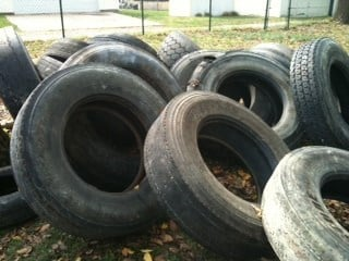 This October 12, 2011 photo shows nearly two dozen tires that were illegal dumped in a south St. Louis backyard on Tuesday. By KMOV Web Producer