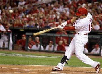 St. Louis Cardinals' Jon Jay hits an RBI double during the first inning of Game 3 of baseball's National League championship series against the Milwaukee Brewers Wednesday, Oct. 12, 2011, in St. Louis. (AP Photo/Matt Slocum) By Matt Slocum