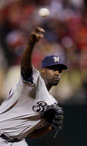 Milwaukee Brewers relief pitcher LaTroy Hawkins throws during the sixth inning of Game 3 of baseball's National League championship series against the St. Louis Cardinals Wednesday, Oct. 12, 2011, in St. Louis. (AP Photo/Matt Slocum) By Matt Slocum