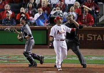 St. Louis Cardinals' Yadier Molina reacts after flying out during the fifth inning of Game 3 of baseball's National League championship series against the Milwaukee Brewers Wednesday, Oct. 12, 2011, in St. Louis. (AP Photo/Jeff Roberson) By Jeff Roberson