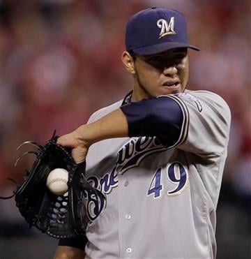 Milwaukee Brewers starting pitcher Yovani Gallardo reacts during the first inning of Game 3 of baseball's National League championship series against the St. Louis Cardinals Wednesday, Oct. 12, 2011, in St. Louis. (AP Photo/Matt Slocum) By Matt Slocum