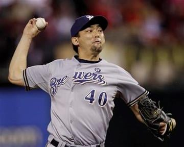 Milwaukee Brewers relief pitcher Takashi Saito throws during the seventh inning of Game 3 of baseball's National League championship series against the St. Louis Cardinals Wednesday, Oct. 12, 2011, in St. Louis. (AP Photo/Matt Slocum) By Matt Slocum