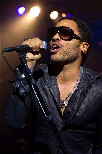 """FILE - In this Aug. 31, 2011 file photo, Lenny Kravitz performs at the Samsung AT&T Summer Krush concert in New York. Kravitz released his ninth album titled """"Black and White America."""" (AP Photo/Charles Sykes, file) By Charles Sykes"""