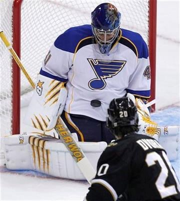 St. Louis Blues goalie Jaroslav Halak (41) stops a shot as Dallas Stars right wing Radek Dvorak (20) looks on during the first period of an NHL hockey game in Dallas, Thursday, Oct. 13, 2011. (AP Photo/LM Otero) By LM Otero