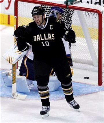 Dallas Stars left wing Brenden Morrow (10) celebrates scoring a goal against St. Louis Blues goalie Jaroslav Halak during the second period of the NHL hockey game in Dallas, Thursday, Oct. 13, 2011. (AP Photo/LM Otero) By LM Otero