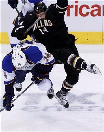 St. Louis Blues center T.J. Oshie (74) and Dallas Stars left wing Jamie Benn (14) collide during the first period of the NHL hockey game in Dallas, Thursday, Oct. 13, 2011. (AP Photo/LM Otero) By LM Otero