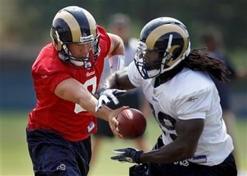 St. Louis Rams quarterback Sam Bradford, left, hands off to running back Steven Jackson during NFL football training camp Thursday, Aug. 18, 2011, at the Rams' training facility in St. Louis. (AP Photo/Jeff Roberson) By Jeff Roberson