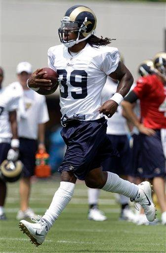 St. Louis Rams running back Steven Jackson runs with the ball during NFL football camp on Sunday, July 31, 2011, at the Rams' training facility in St. Louis. (AP Photo/Jeff Roberson) By Jeff Roberson