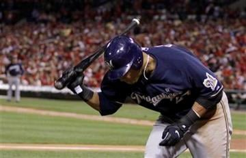Milwaukee Brewers' Carlos Gomez reacts after striking out during the fifth inning of Game 5 of baseball's National League championship series against the St. Louis Cardinals Friday, Oct. 14, 2011, in St. Louis. (AP Photo/Matt Slocum) By Matt Slocum