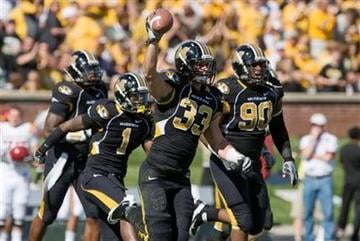 Missouri linebacker Luke Lambert, center, holds up the ball in the air after he recovered an Iowa State fumble during the first half of an NCAA college football game Saturday, Oct. 15, 2011, in Columbia, Mo. (AP Photo/L.G. Patterson) By L.G. Patterson