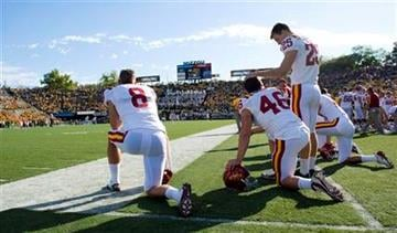 Iowa State's Brett Bueker (8), Dakota Zimmerman (46) and Zach Guyer (25) watch the final minutes in their 52-17 loss to Missouri in an NCAA college football game on Saturday, Oct. 15, 2011, in Columbia, Mo. (AP Photo/L.G. Patterson) By L.G. Patterson