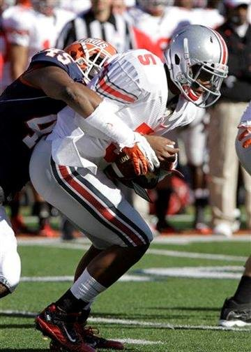 Illinois linebacker Jonathan Brown (45) sacks Ohio State quarterback Braxton Miller (5) during the first half of an NCAA college football game Saturday, Oct. 15, 2011, in Champaign, Ill. Ohio State won 17-7. (AP Photo/Seth Perlman) By Seth Perlman