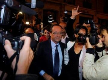 French candidate for the 2011 Socialist party primary elections Francois Hollande arrives at the?Socialist?Party headquarters in?Paris after winning the socialist primary election, Paris, Sunday Oct, 16, 2011. (AP Photo/Michel Spingler) By Michel Spingler
