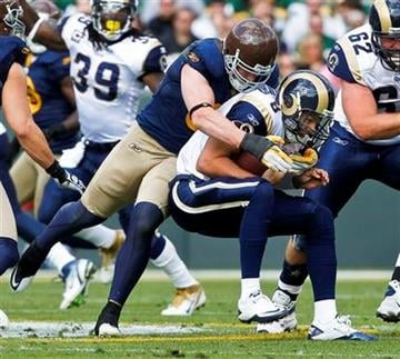 Green Bay Packers inside linebacker A.J. Hawk sacks St. Louis Rams quarterback Sam Bradford during the first half of an NFL football game Sunday, Oct. 16, 2011, in Green Bay, Wis. (AP Photo/Jeffrey Phelps) By Jeffrey Phelps