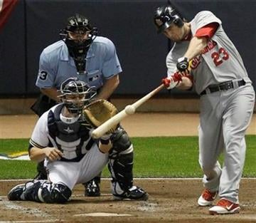 St. Louis Cardinals' David Freese hits a three-run home run during the first inning of Game 6 of baseball's National League championship series against the Milwaukee Brewers Sunday, Oct. 16, 2011, in Milwaukee. (AP Photo/Jeff Roberson) By Jeff Roberson