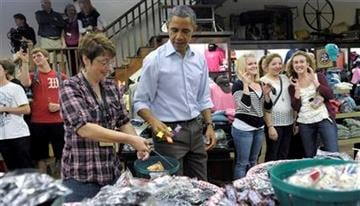 President Barack Obama shops for candy at Mast General Store in Boone, N.C., Monday, Oct. 17, 2011. Obama is on a three-day bus tour promoting the American Jobs Act. (AP Photo/Susan Walsh) By Susan Walsh