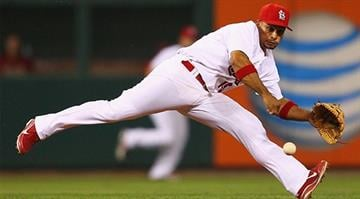 ST. LOUIS, MO - AUGUST 15: Rafael Furcal #15 of the St. Louis Cardinals fields a one hopper against the Arizona Diamondbacks at Busch Stadium on August 15, 2012 in St. Louis, Missouri. (Photo by Dilip Vishwanat/Getty Images)