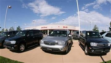 FILE - In this Aug. 27, 2006 file photo, a trio of unsold 2006 Buick Rainier sports utility vehicles sits in front of a Buick dealership.(AP Photo/David Zalubowski, File) By DAVID ZALUBOWSKI