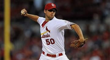 ST. LOUIS, MO - AUGUST 21: Adam Wainwright #50 of the St. Louis Cardinals throws to a Houston Astros batter at Busch Stadium on August 21, 2012 in St. Louis, Missouri. (Photo by Jeff Curry/Getty Images)