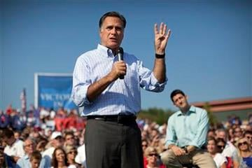 Republican presidential candidate, former Massachusetts Gov. Mitt Romney speaks as vice presidential running mate Rep. Paul Ryan, R-Wis., listens during a campaign rally on Saturday, Aug. 25, 2012 in Powell, Ohio.  (AP Photo/Evan Vucci) By Evan Vucci
