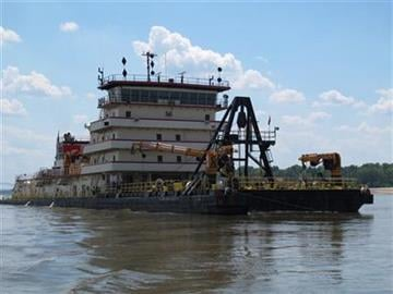 The 350-foot U.S. Army Corps of Engineers' Dredge Hurley works to clear a navigation channel on the Mississippi River on Monday, Aug. 20, 2012 near Memphis, Tenn. (AP Photo/Adrian Sainz) By Adrian Sainz