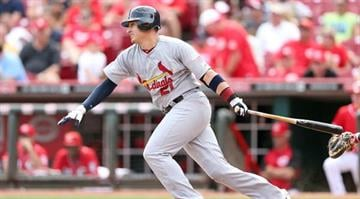 Allen Craig #21 of the St. Louis Cardinals hits a single during the game against the Cincinnati Reds at Great American Ball Park on August 26, 2012 in Cincinnati, Ohio.  (Photo by Andy Lyons/Getty Images) By Andy Lyons