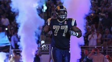 ST. LOUIS - SEPTEMBER 11: Jason Smith #77 of the St. Louis Rams takes the field against the Philadelphia Eagles at the Edward Jones Dome on September 11, 2011 in St. Louis, Missouri. (Photo by Dilip Vishwanat/Getty Images)