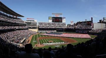 MINNEAPOLIS, MN - APRIL 08: The national anthem is played before the game between the Minnesota Twins and the Oakland Athletics during Opening Day on April 8, 2011 at Target Field in Minneapolis, Minnesota. (Photo by Elsa/Getty Images)