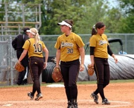 Abby Vock (l), Ashley Fleming (c), and Jana Hainey (r) go to their defensive positions after a team huddle, Sunday, May 2, 2010 at University Field in Columbia, Mo. against the Baylor Bears. By Denisha Thomas