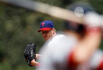 Philadelphia Phillies' Roy Halladay, left, prepares to pitch to St. Louis Cardinals' Nick Stavinoha in the first inning of a baseball game, Thursday, May 6, 2010, in Philadelphia. (AP Photo/Matt Slocum) By Matt Slocum