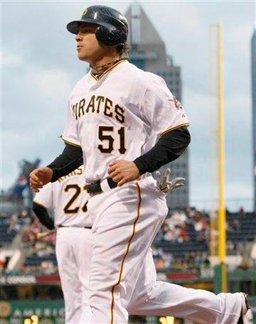 Pittsburgh Pirates' Steve Pearce trots back to the dugout after scoring against the St. Louis Cardinal in the second inning of the baseball game in Pittsburgh,  Saturday, May 8, 2010. (AP Photo/Keith Srakocic) By Keith Srakocic