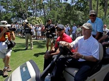 Tiger Woods (red shirt) is driven off the course after an injury on the seventh hole during the final round of The Players Championship golf tournament Sunday, May 9, 2010, in Ponte Vedra Beach, Fla. (AP Photo/Chris O'Meara) By Chris O'Meara