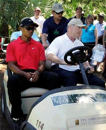 Tiger Woods is driven off the course after a neck injury on the 7th hole during the final round of The Players Championship golf tournament Sunday, May 9, 2010, in Ponte Vedra Beach, Fla. (AP Photo/Chris O'Meara) By Chris O'Meara